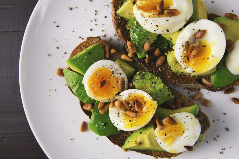Healthy food snack of eggs and avocado on toasted bread